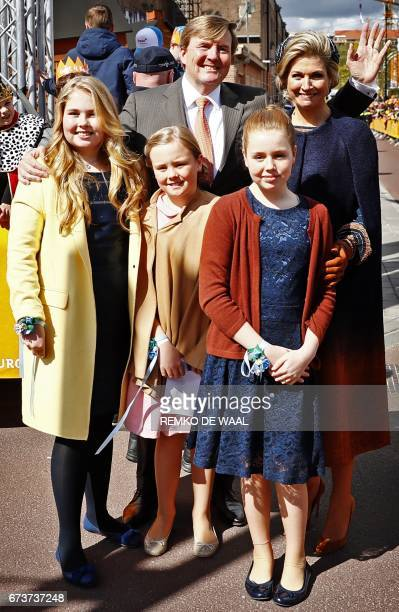 King Willem Alexander Queen Maxima and their daughters Amalia Ariane and Alexia pose in Tilburg on April 27 2017 as they celebrate the King's day...
