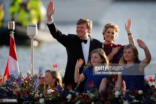 King Willem Alexander Queen Maxima and their daughters Princess Catharina Amalia Princess Ariane and Princess Alexia of the Netherlands wave to the...