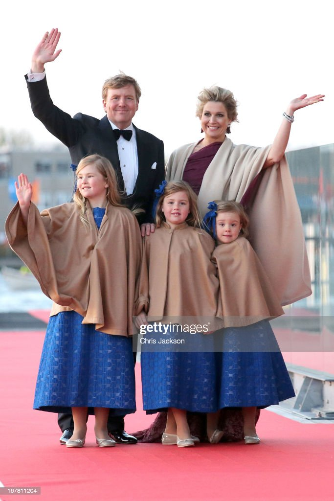 King Willem Alexander; Queen Maxima and their daughters <a gi-track='captionPersonalityLinkClicked' href=/galleries/search?phrase=Princess+Catharina-Amalia&family=editorial&specificpeople=765983 ng-click='$event.stopPropagation()'>Princess Catharina-Amalia</a>; Princess Alexia and Princess Ariane of The Netherlands arrive at the Muziekbouw following the water pageant after the abdication of Queen Beatrix of the Netherlands and the Inauguration of King Willem Alexander of the Netherlands on April 30, 2013 in Amsterdam, Netherlands.