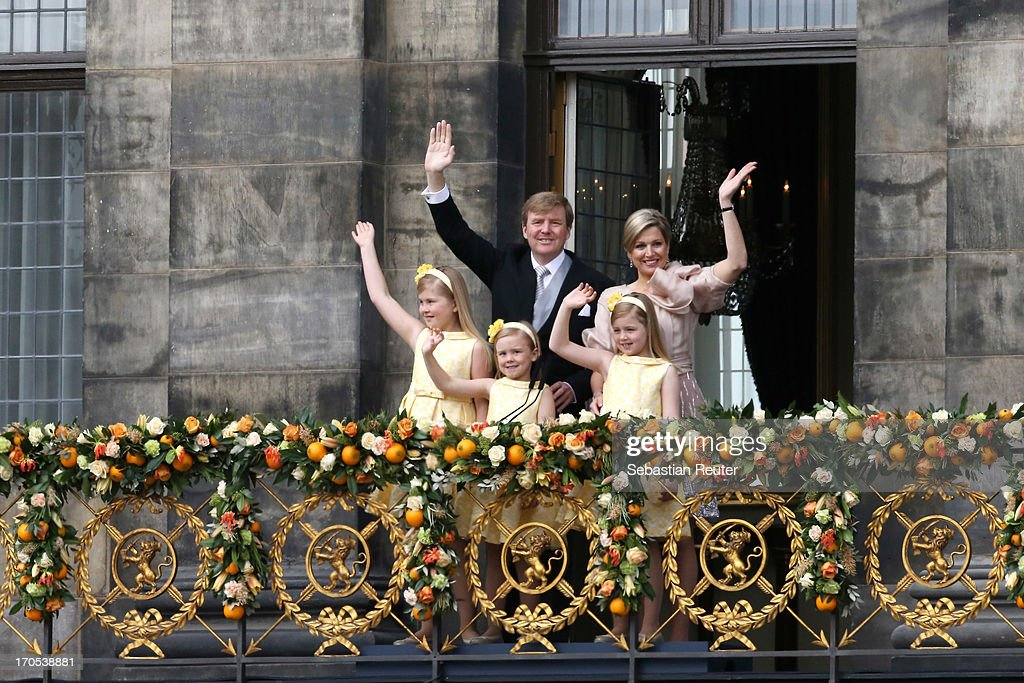 King Willem Alexander, Queen Maxima and their daughters Princess Catharina Amalia, Princess Ariane and <a gi-track='captionPersonalityLinkClicked' href=/galleries/search?phrase=Princess+Alexia+of+the+Netherlands&family=editorial&specificpeople=766259 ng-click='$event.stopPropagation()'>Princess Alexia of the Netherlands</a> appear on the balcony of the Royal Palace to greet the public after the abdication of Queen Beatrix of The Netherlands and ahead of the Inauguration of King Willem Alexander of The Netherlands on April 30, 2013 in Amsterdam, Netherlands.