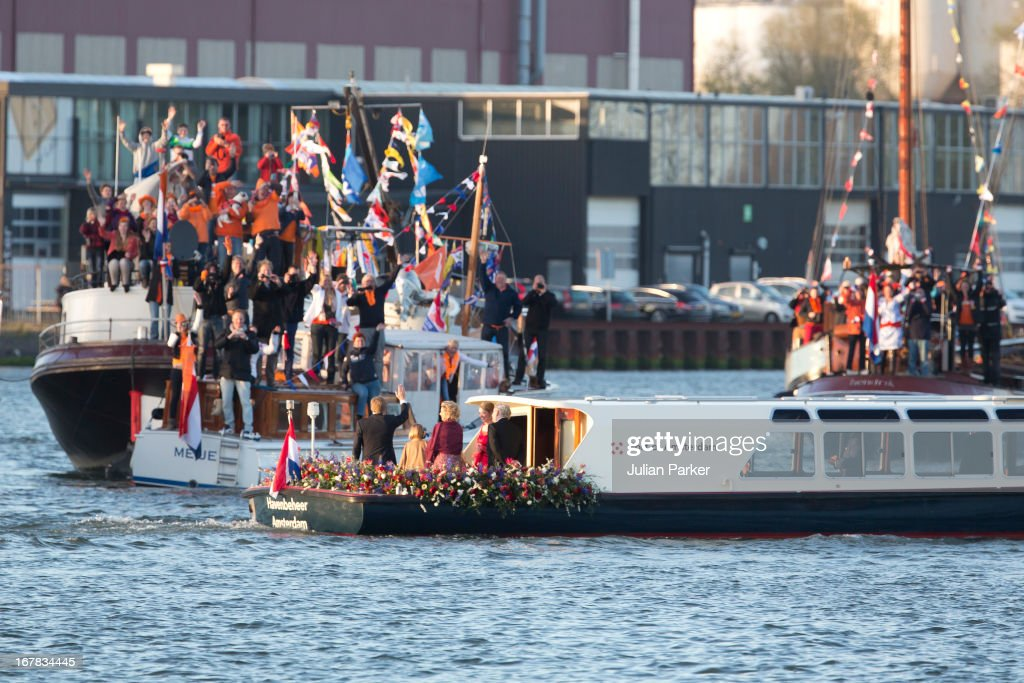 King Willem, and Queen Maxima of the Netherlands, and their daughters, Princess Catharina-Amalia, Princess Alexia, and Princess Ariane, aboard the Kings Boat waving to crowds during the water pageant to celebrate the inauguration of King Willem Alexander of the Netherlands on April 30, 2013 in Amsterdam, Netherlands.