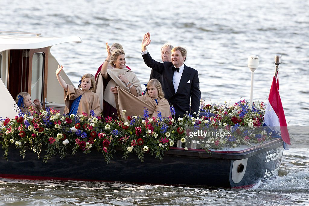King Willem, and Queen Maxima of the Netherlands, and their daughters, <a gi-track='captionPersonalityLinkClicked' href=/galleries/search?phrase=Princess+Catharina-Amalia&family=editorial&specificpeople=765983 ng-click='$event.stopPropagation()'>Princess Catharina-Amalia</a>, Princess Alexia, and Princess Ariane, aboard the Kings Boat waving to crowds during the water pageant to celebrate the inauguration of King Willem Alexander of the Netherlands on April 30, 2013 in Amsterdam, Netherlands.