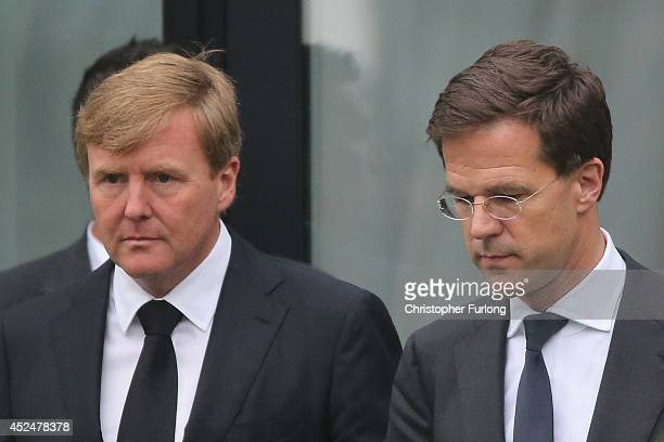 King WillemAlexander and Dutch Prime Minister Mark Rutte leave the Congresscentrum Utrecht after meeting relatives of the victims of Malaysia...