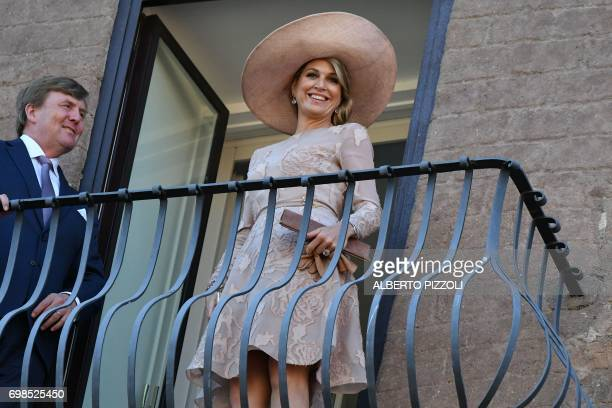 King WillemAlexander and Queen Maxima of Netherlands stand on the balcony of Rome City Hall during a meeting with Rome's mayor Virginia Raggi on June...