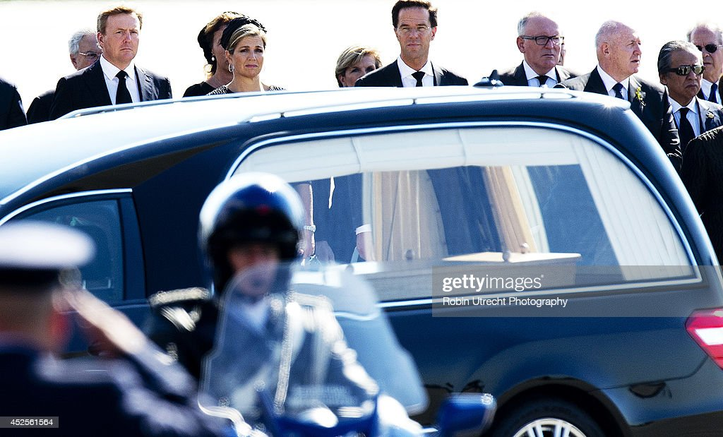 King WillemAlexander and Queen Maxima of The Netherlands and Dutch Prime minister Mark Rutte attend a ceremony upon the arrivals of a plane from...