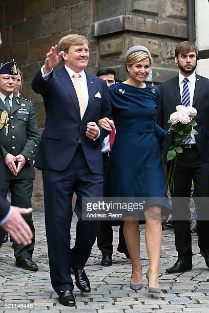 King WillemAlexander and Queen Maxima of the Netherlands are greeted by a large crowd after their visit of Albrecht Duerer's House on April 14 2016...