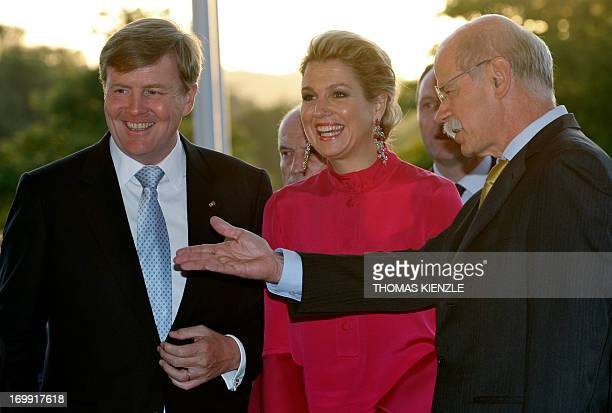 King WillemAlexander and Queen Maxima of the Netherlands are welcomed by CEO of Daimler AG Dieter Zetsche at the MercedesBenz museum in Stuttgart...