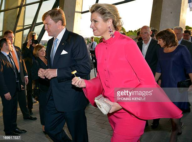 King WillemAlexander and Queen Maxima of the Netherlands arrive at the MercedesBenz museum in Stuttgart southwestern Germany on June 4 2013 AFP PHOTO...
