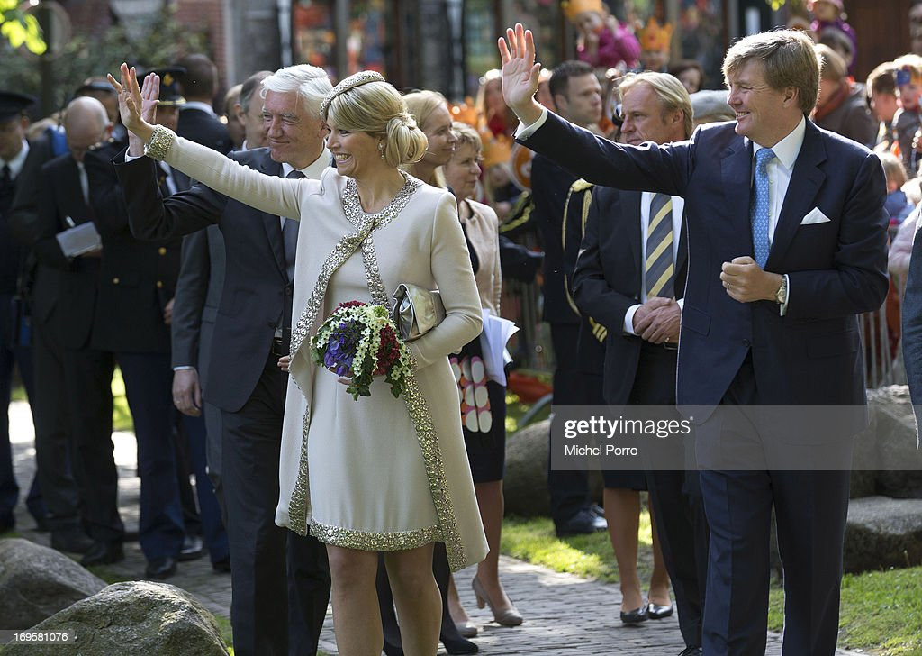 King Willem-Alexander and Queen Maxima of The Netherlands arrive for a one day visit to Groningen and Drenthe provinces at Martinikerkhof on May 28, 2013 in Groningen, Netherlands.