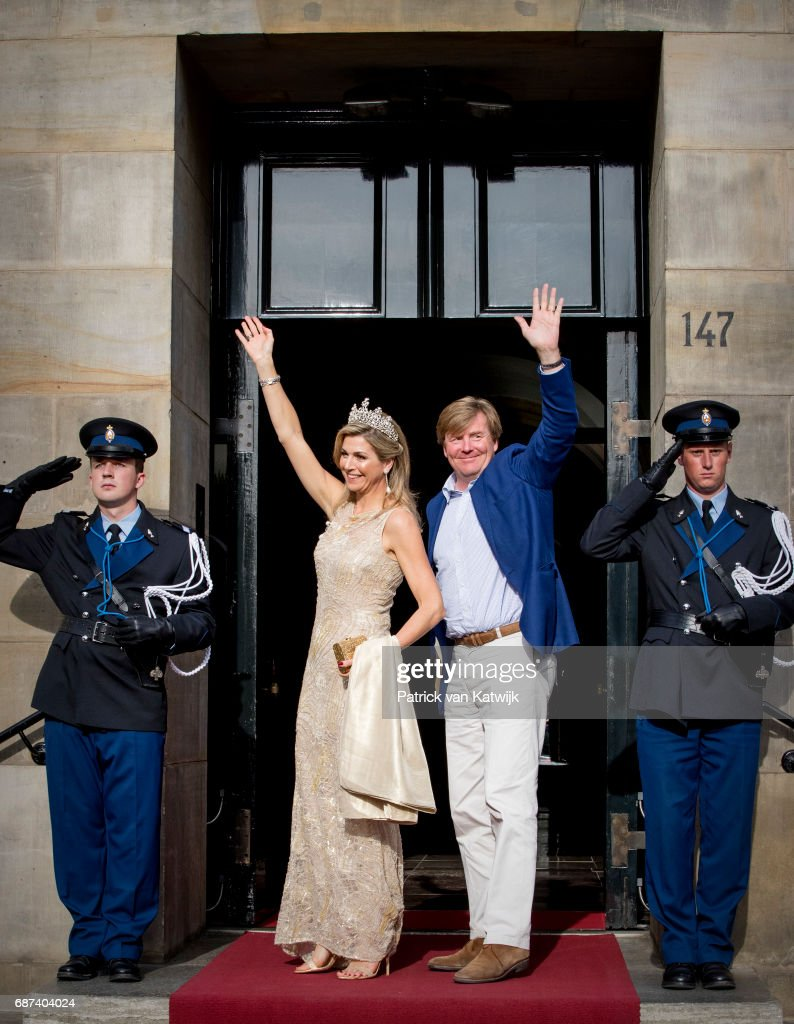 King Willem-Alexander and Queen Maxima of The Netherlands arrive for the gala dinner for the Corps Diplomatic at the Royal Palace on May 23, 2017 in Amsterdam, Netherlands.