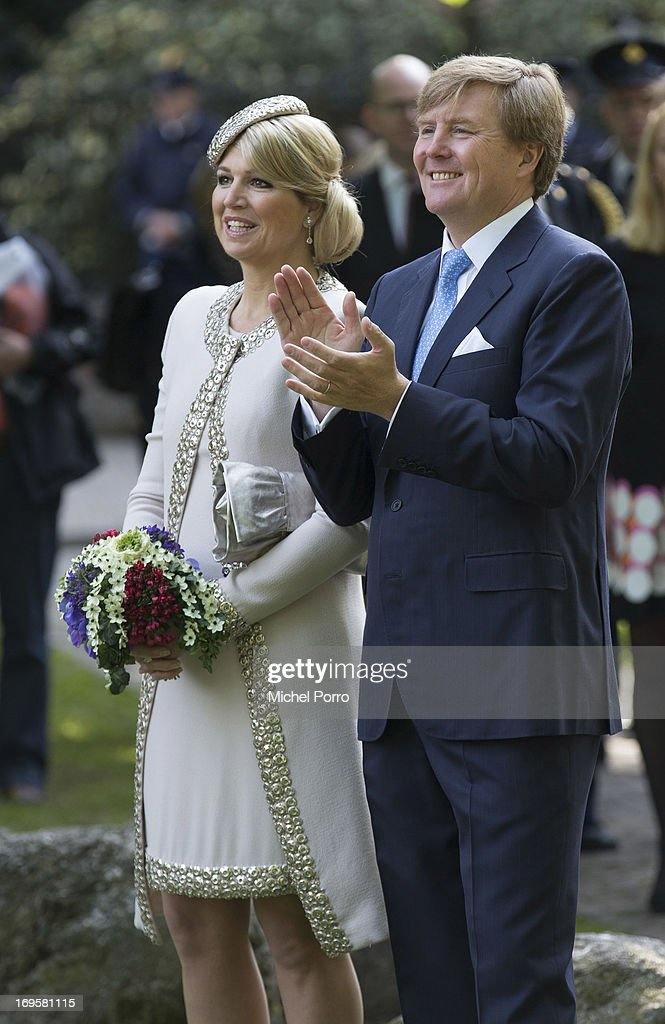 King Willem-Alexander and Queen Maxima of The Netherlands arrive in Groningen for a one day visit to Groningen and Drenthe provinces at Martinikerkhof on May 28, 2013 in Groningen, Netherlands.
