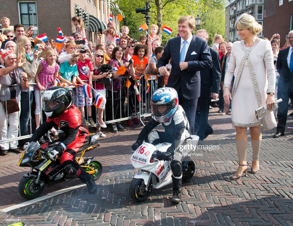 King Willem-Alexander and Queen Maxima of The Netherlands look at small motor bikes during their one day visit to Groningen and Drenthe provinces on May 28, 2013 in Assen, Netherlands. Assen is the TT city of The netherlands.
