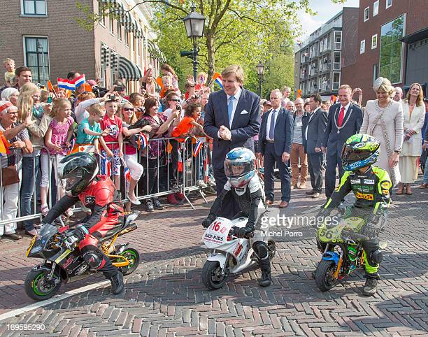 King WillemAlexander and Queen Maxima of The Netherlands look at small motor bikes during their one day visit to Groningen and Drenthe provinces on...