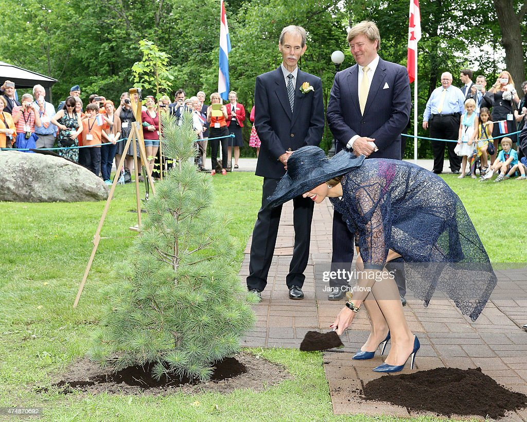 King WillemAlexander and Queen Maxima of The Netherlands participate in a tree planting ceremony on the Rideau Hall grounds during a during a state...