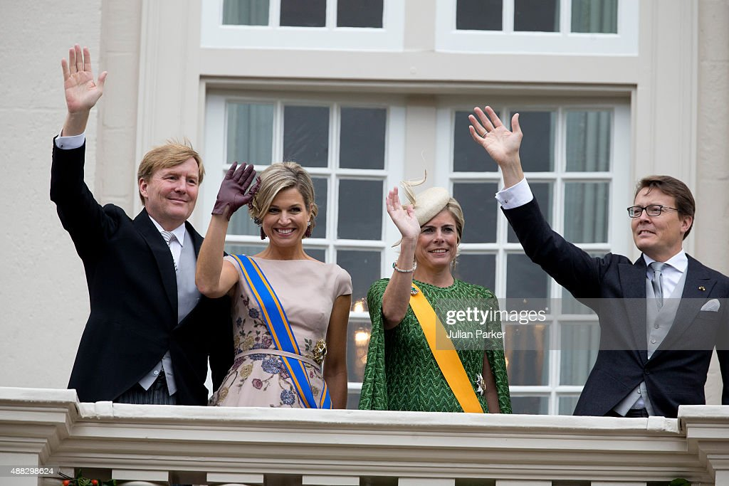 King Willem-Alexander and Queen Maxima of The Netherlands, Princess Laurentien of The Netherlands and Prince Constantijn of the the Netherlands on the balcony of The Noordeinde Palace during Prinsjesdag (Prince's Day) on September 15, 2015 in The Hague, Netherlands.