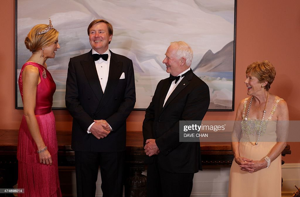 King Willem-Alexander (2nd L) and Queen Maxima (L) of the Netherlands share a smile with Canada Governor General David Johnston (2nd R) and his wife Sharon (R) during the State Dinner at Rideau Hall on May 27, 2015 in Ottawa, Canada. The King and Queen are on a three-day visit to Canada.