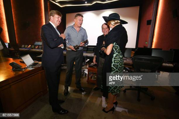 King WillemAlexander and Queen Maxima of the Netherlands speak to Oscar winner Michael Hedges and Joe Letteri during a visit to Park Road in...