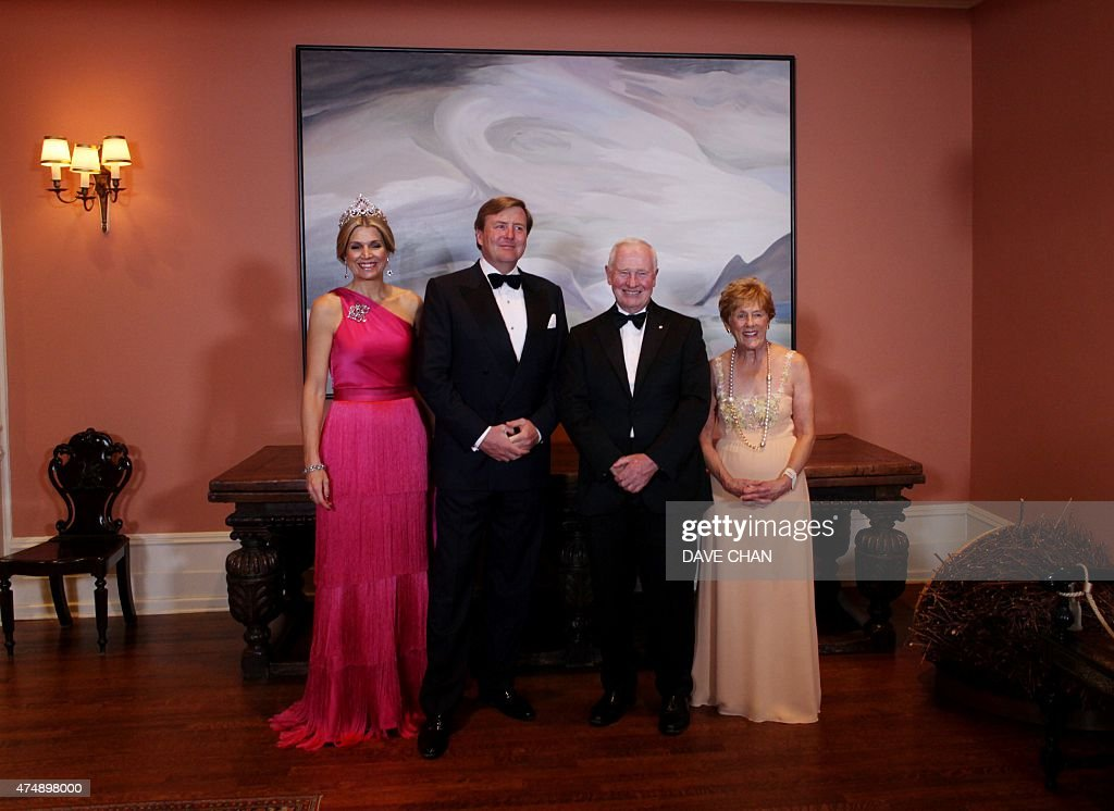 King Willem-Alexander (2nd L) and Queen Maxima (L) of the Netherlands stand with Canada Governor General David Johnston (2nd R) and his wife Sharon (L) for a group photograph during the State Dinner at Rideau Hall May 27, 2015 in Ottawa, Canada. The King and Queen are on a three-day visit to Canada.