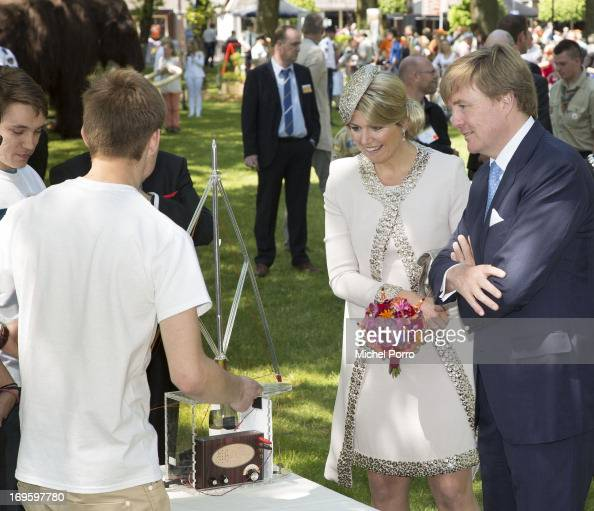 King WillemAlexander and Queen Maxima of The Netherlands talk with a radio amateur during a one day visit to Groningen and Drenthe provinces at...