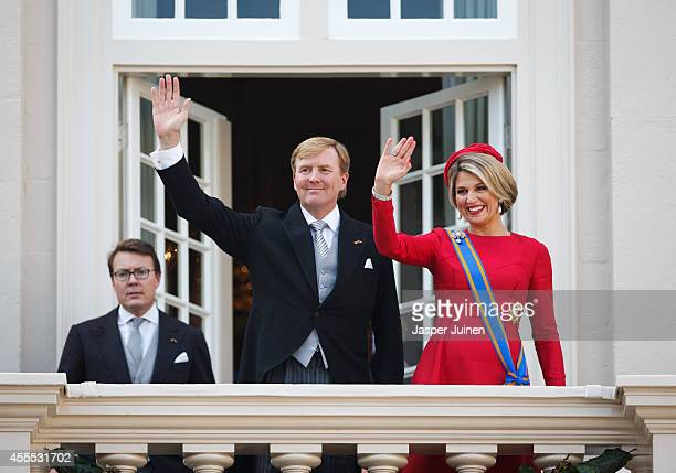 King WillemAlexander and Queen Maxima of the Netherlands wave from the Noordeinde palace balcony on September 16 2014 in The Hague Netherlands The...