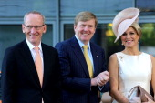 King WillemAlexander and Queen Maxima of The Netherlands with KarlThomas Neumann chief executive officer of Opel AG during a visit to the Opel...