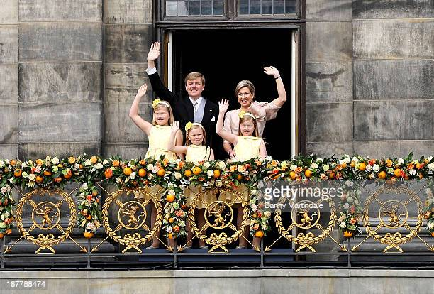 King WillemAlexander of the Netherlands and HM Queen Maxima of the Netherlands appear on the balcony of the Royal Palace with their daughters...