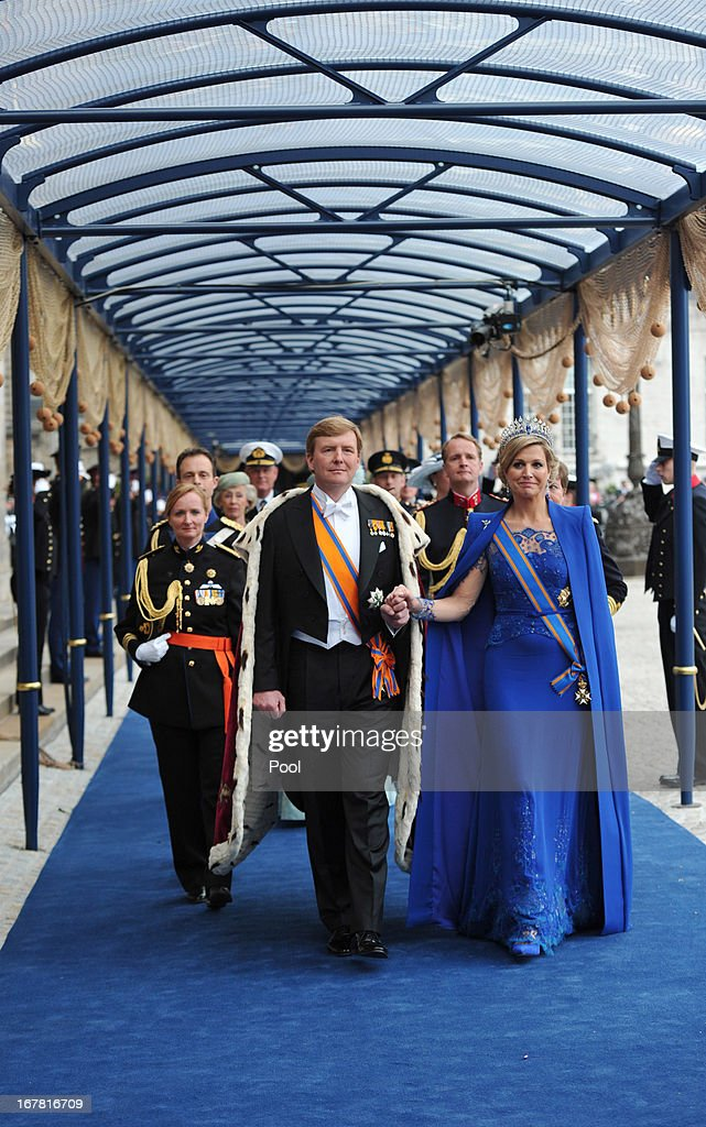 HM <a gi-track='captionPersonalityLinkClicked' href=/galleries/search?phrase=King+Willem-Alexander&family=editorial&specificpeople=160214 ng-click='$event.stopPropagation()'>King Willem-Alexander</a> of the Netherlands and HM Queen Maxima of the Netherlands leave following the inauguration ceremony at New Church on April 30, 2013 in Amsterdam, Netherlands.
