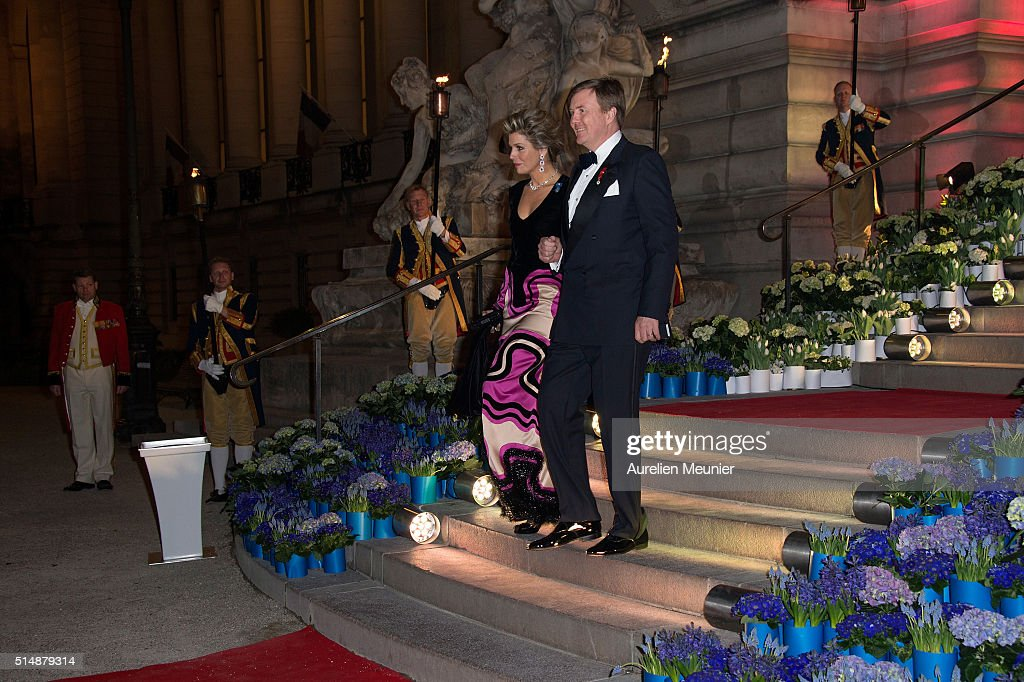 King Willem-Alexander of the Netherlands and Queen Maxima are walking down the stairs to welcome French President Francois Hollande to a reception given by King Willem-Alexander of the Netherlands and Queen Maxima in honor of the French President Francois Hollande at Le Petit Palais on March 11, 2016 in Paris, France. Queen Maxima and King Willem-Alexander of The Netherlands are on a two-day state visit in France