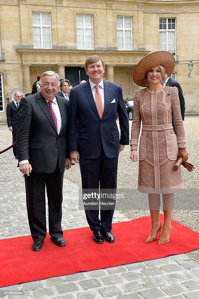 King Willem-Alexander (C) of the Netherlands and Queen Maxima (R) arrive at the Senate for a meeting with the President of the Senate Gerard Larcher (L) on March 10, 2016 in Paris, France. Queen Maxima and King Willem-Alexander are on a two-day state visit in France.