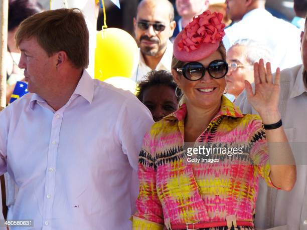 King WillemAlexander of the Netherlands and Queen Maxima of the Netherlands during a visit to the fishing pier at West Point on November 19 2013 in...