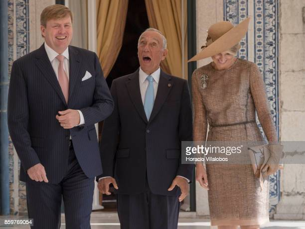King WillemAlexander of The Netherlands and Queen Maxima of The Netherlands share a laugh with Portuguese President Marcelo Rebelo de Sousa in a...
