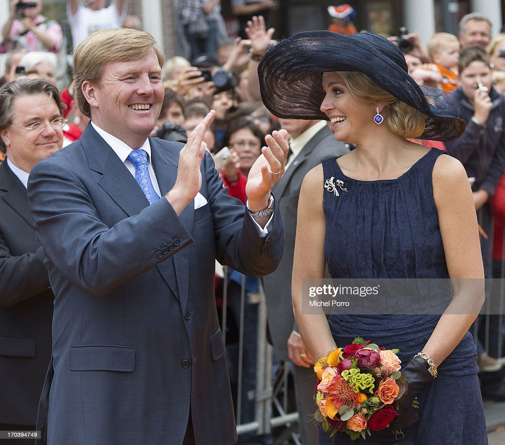 King Willem-Alexander of the Netherlands and Queen Maxima of The Netherlands (R) during an official visit as part of the Coronation Tour on June 12, 2013 in Roosendaal, Netherlands.