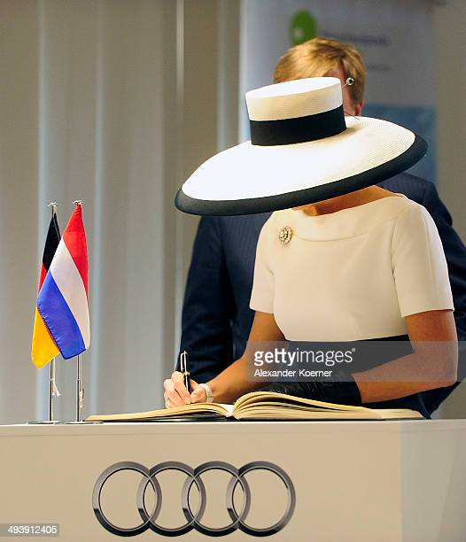 King WillemAlexander of the Netherlands and Queen Maxima of the Netherlands are pictured inside the AUDI eGas research facility on May 26 2014 in...