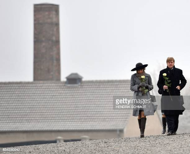 King WillemAlexander of the Netherlands and Queen Maxima of the Netherlands carry roses as they visit the Buchenwald memorial on the grounds of the...