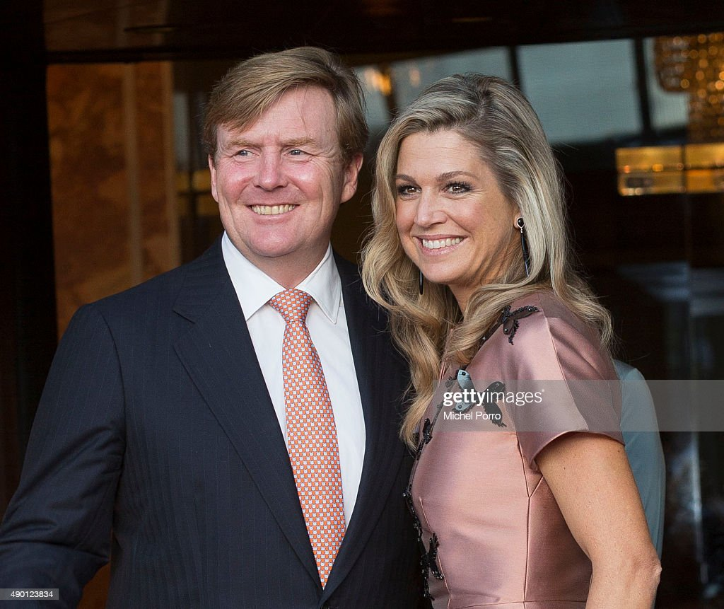 King Willem-Alexander of The Netherlands (L) and Queen Maxima of The Netherlands (wearing a dress by Flemish designer Natan) arrive for festivities marking the final celebrations of 200 years Kingdom of The Netherlands on September 26, 2015 in Amsterdam, Netherlands