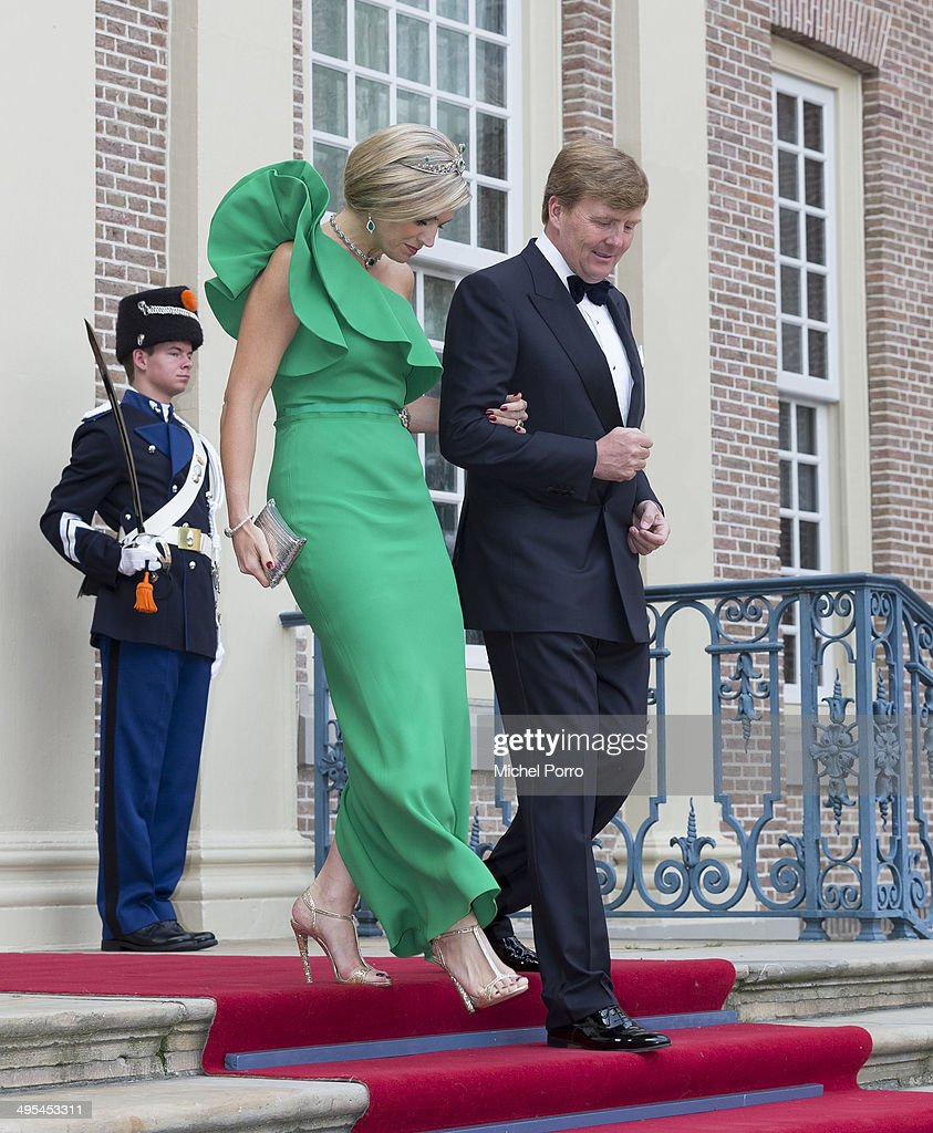 King Willem-Alexander of The Netherlands and Queen Maxima of The Netherlands arrive for dinner at the Loo Royal Palace on June 3, 2014 in Apeldoorn, Netherlands.