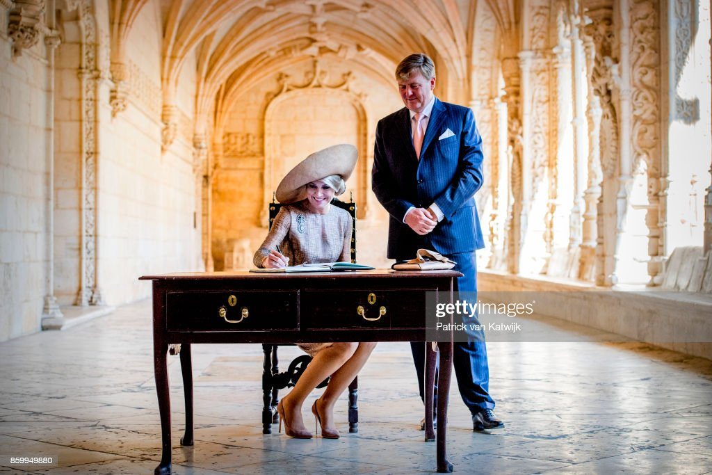 King Willem-Alexander of The Netherlands and Queen Maxima of The Netherlands lay down a wreath at the tomb of poet Luis Vaz de Camoes followed by a tour through the monasteryon October 10, 2017 in Lisboa CDP, Portugal.
