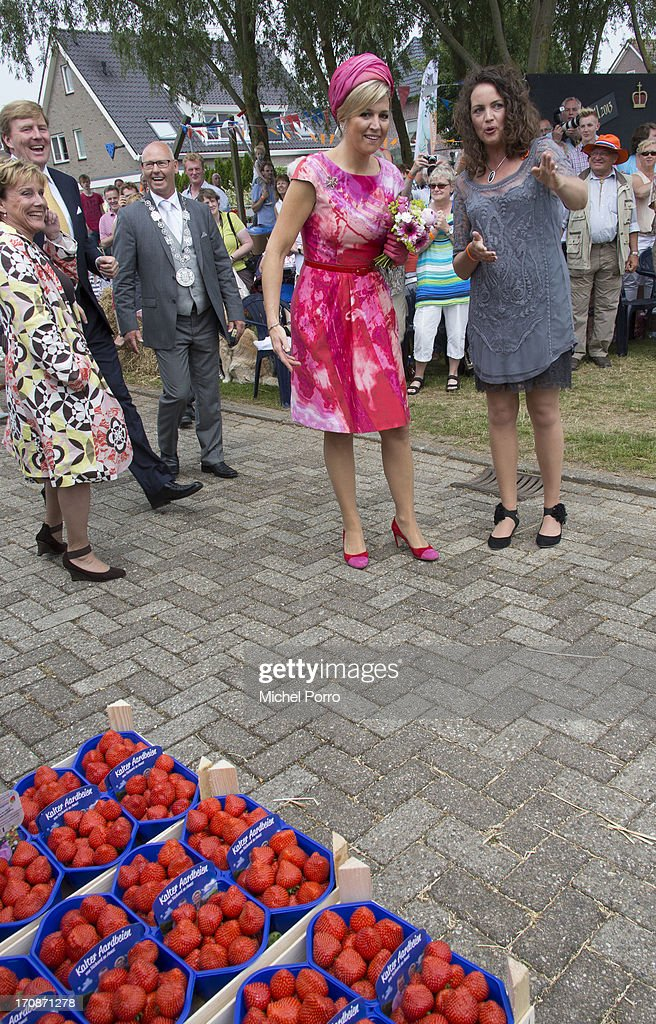 King Willem-Alexander of The Netherlands and Queen Maxima of The Netherlands make an official visit to the town centre on June 19, 2013 in 's-Heerenbroek, Netherlands.