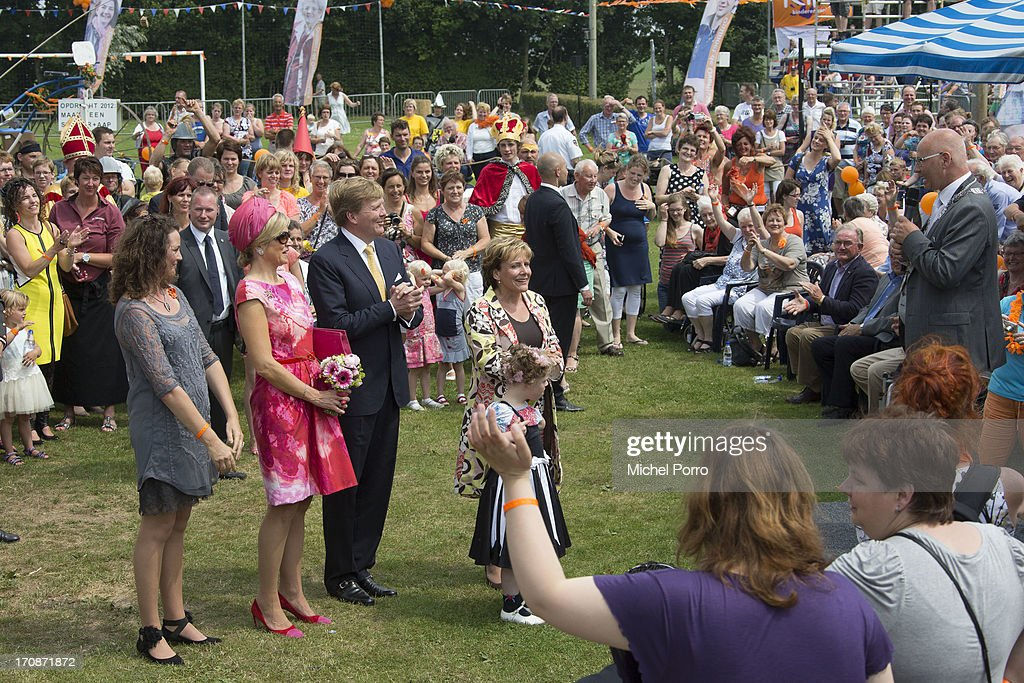 King Willem-Alexander of The Netherlands and Queen Maxima of The Netherlands make at official visit to the town centre on June 19, 2013 in 's-Heerenbroek, Netherlands.