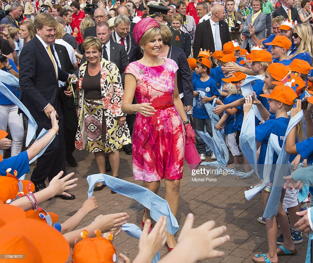 <a gi-track='captionPersonalityLinkClicked' href=/galleries/search?phrase=King+Willem-Alexander&family=editorial&specificpeople=160214 ng-click='$event.stopPropagation()'>King Willem-Alexander</a> of The Netherlands and Queen Maxima of The Netherlands make an official visit to the town centre on June 19, 2013 in Goor, Netherlands.