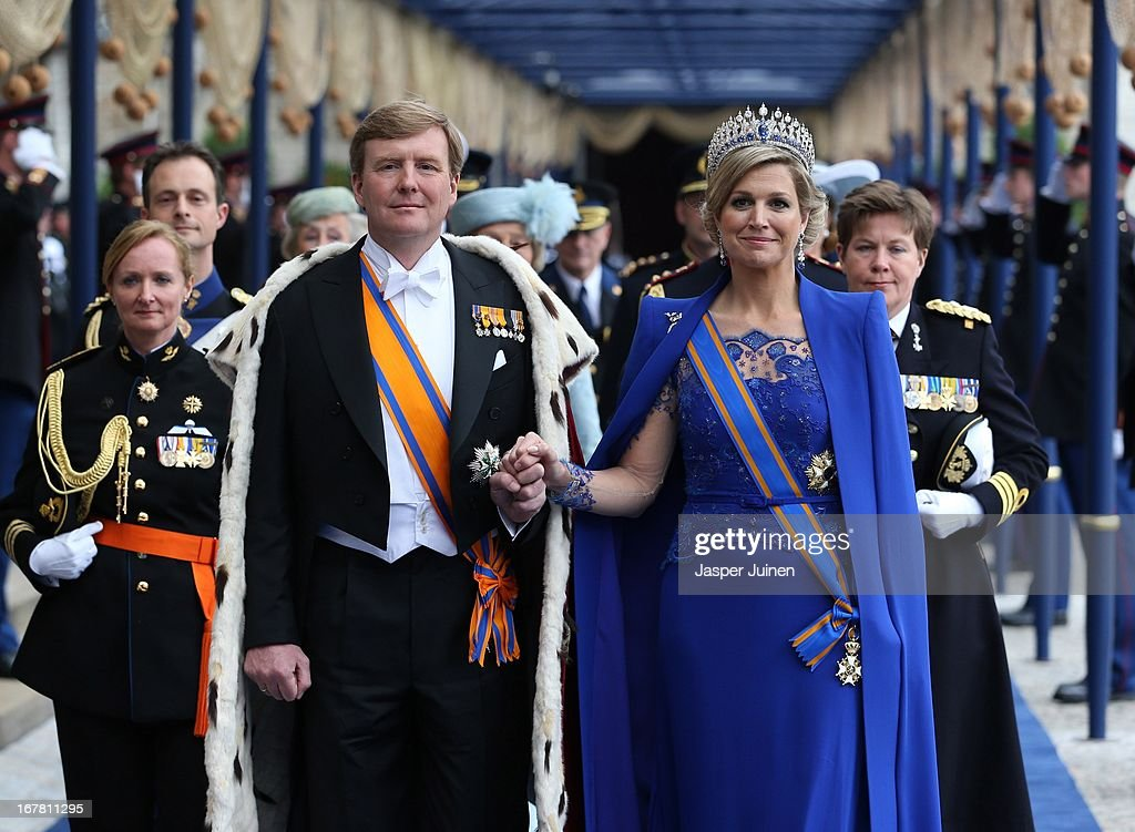 <a gi-track='captionPersonalityLinkClicked' href=/galleries/search?phrase=King+Willem-Alexander&family=editorial&specificpeople=160214 ng-click='$event.stopPropagation()'>King Willem-Alexander</a> of the Netherlands and Queen Maxima of the Netherlands (R) leave after the inauguration ceremony of King Willem Alexander of the Netherlands and Queen Maxima of the Netherlands, at New Church on April 30, 2013 in Amsterdam, Netherlands.