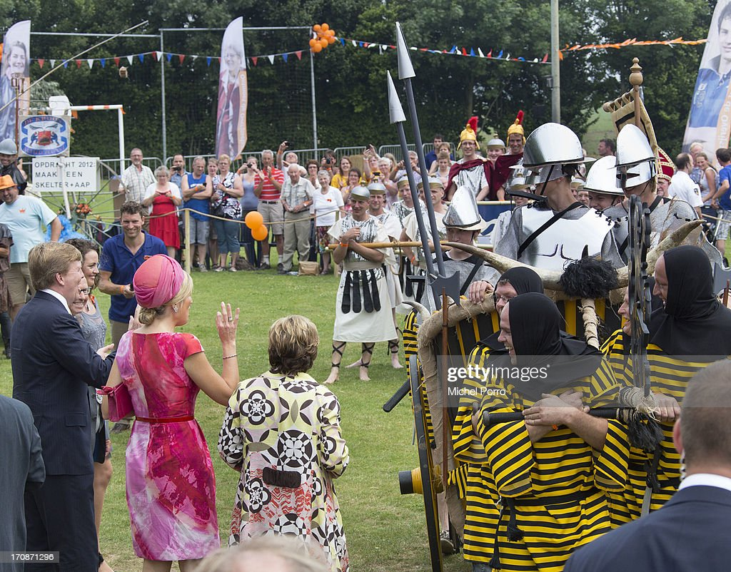 King Willem-Alexander of The Netherlands and Queen Maxima of The Netherlands watch activities during an official visit to the town centre on June 19, 2013 in 's-Heerenbroek, Netherlands.