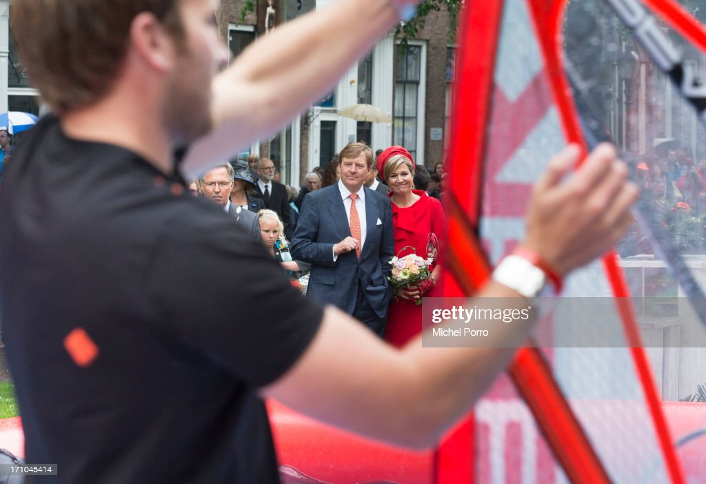 <a gi-track='captionPersonalityLinkClicked' href=/galleries/search?phrase=King+Willem-Alexander&family=editorial&specificpeople=160214 ng-click='$event.stopPropagation()'>King Willem-Alexander</a> of The Netherlands and Queen Maxima of The Netherlands watch watersport activities in Zierikzee on June 21, 2013 in Middelburg, Netherlands.