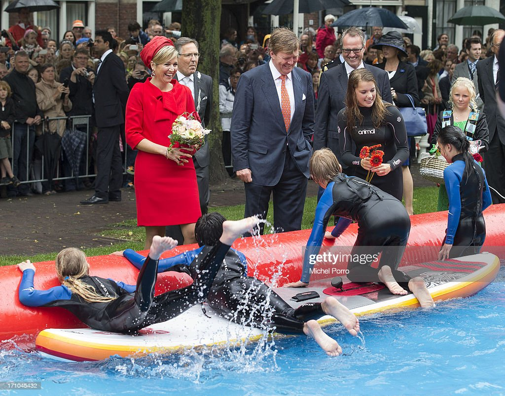 King Willem-Alexander of The Netherlands and Queen Maxima of The Netherlands watch watersport activities in Zierikzee on June 21, 2013 in Middelburg, Netherlands.