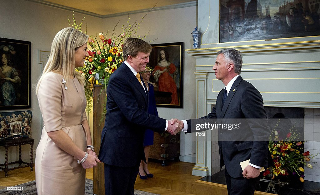 King Willem-Alexander of The Netherlands and Queen Maxima of The Netherlands greet Switzerland President <a gi-track='captionPersonalityLinkClicked' href=/galleries/search?phrase=Didier+Burkhalter&family=editorial&specificpeople=6269147 ng-click='$event.stopPropagation()'>Didier Burkhalter</a> at the Royal Palace Huis ten Bosch on March 24, 2014 in The Hague, Netherlands. The Nuclear Security Summit, held March 24-25, will be attended by world leaders and is aimed at preventing nuclear terrorism.
