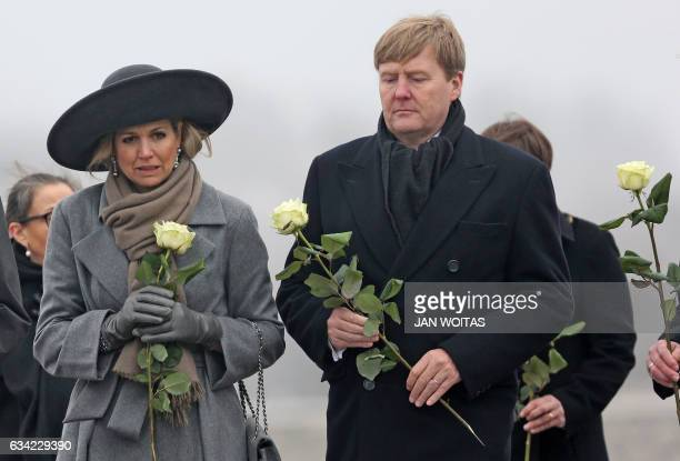 King WillemAlexander of the Netherlands and Queen Maxima of the Netherlands carry white roses as they visit the Buchenwald memorial on the grounds of...