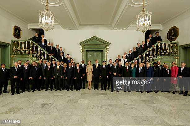 King WillemAlexander of The Netherlands and Queen Maxima of The Netherlands pose for a group ohotograph with members of the Nuclear Security Summit...
