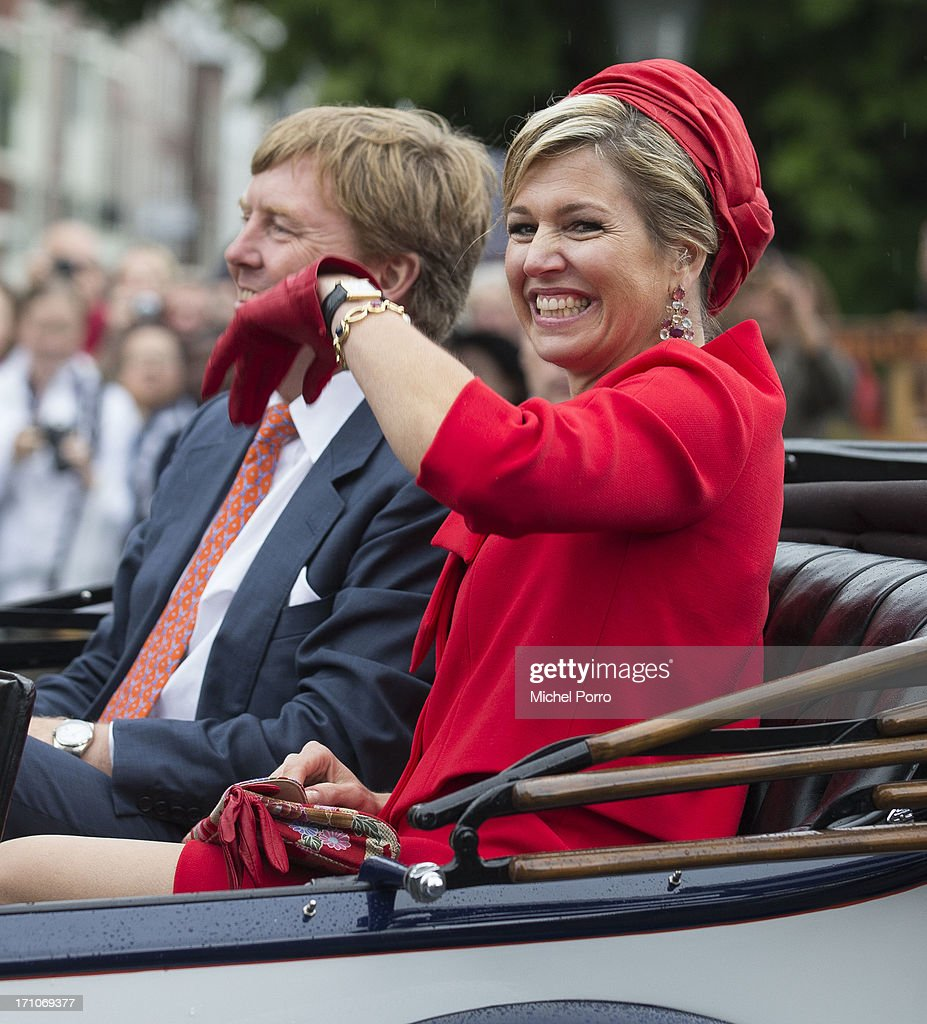 <a gi-track='captionPersonalityLinkClicked' href=/galleries/search?phrase=King+Willem-Alexander&family=editorial&specificpeople=160214 ng-click='$event.stopPropagation()'>King Willem-Alexander</a> of The Netherlands and Queen Maxima of The Netherlands take a ride in a classic car during their visit to The Hagueon June 21, 2013 in The Hague, Netherlands.
