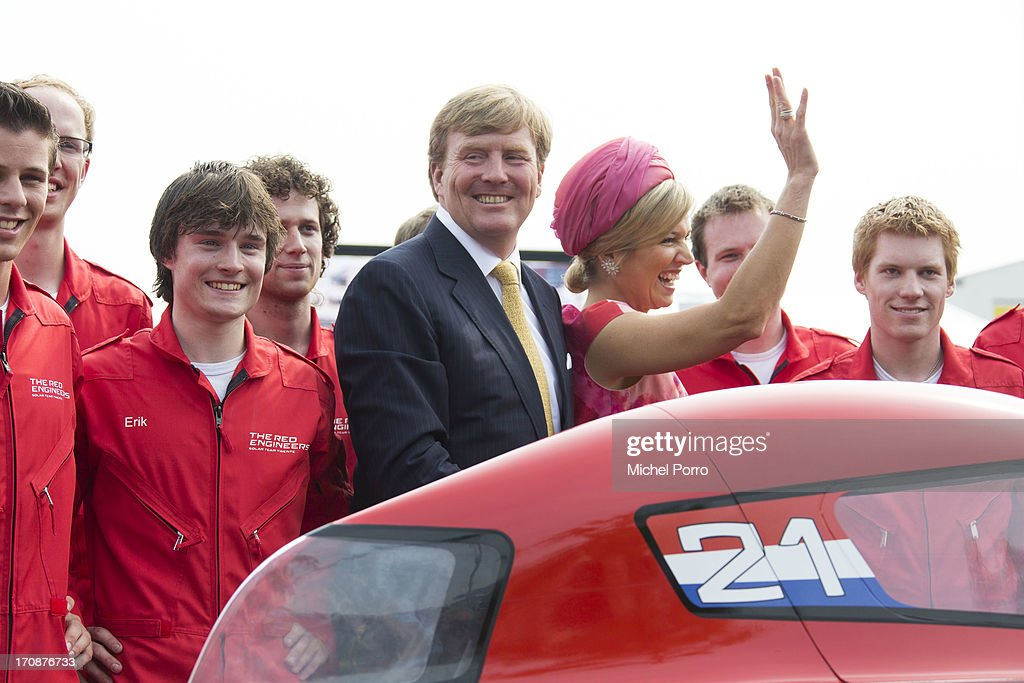 King Willem-Alexander of The Netherlands and Queen Maxima of The Netherlands uveil the Red Engine Solar Team Twente solar car during an official visit to the town centre on June 19, 2013 in Goor, Netherlands.