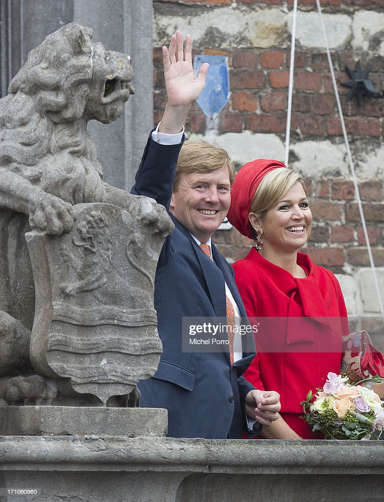 King Willem-Alexander of The Netherlands and Queen Maxima of The Netherlands salute the crown during their visit on June 21, 2013 in Goes, Netherlands.